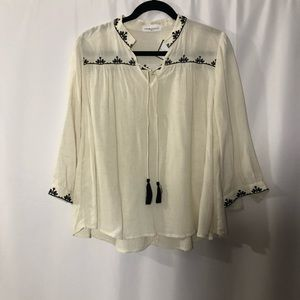Embroidered blouse with tassels